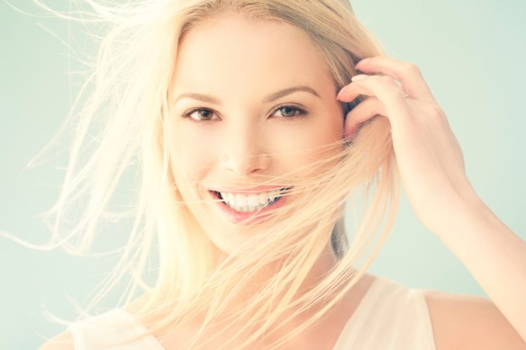 Dental Implants news - beautiful woman smiling 750x500 - News news - beautiful woman smiling 750x500 - News